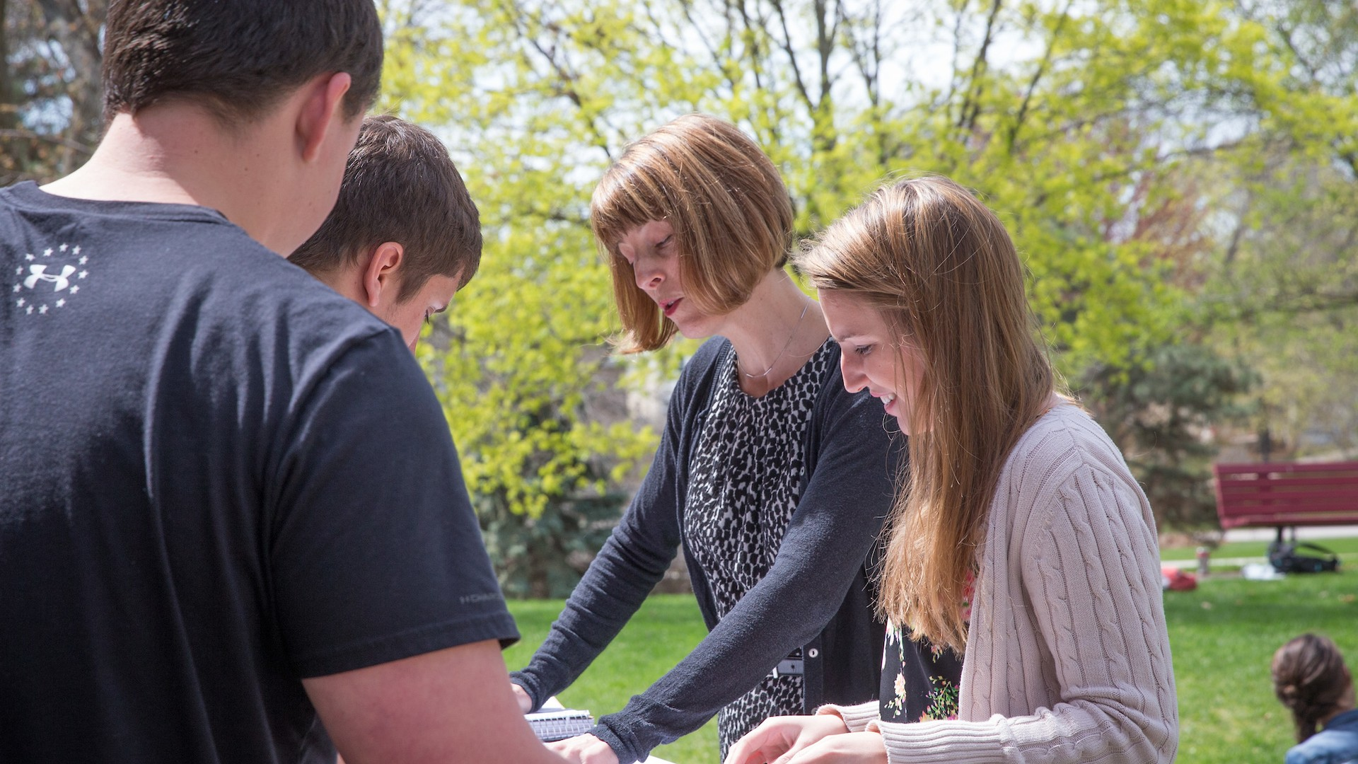 female instructor teaching students outdoors